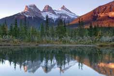 """A dawn photograph of the 'Three Sisters' reflected in the Bow River taken just east of Canmore [Alberta]"" by Cszmurlo . License: http://ift.tt/jZYNfT Photo: http://ift.tt/1Nzn4Sn  #alberta #nature #naturelovers #realestate #realestatebroker #remax #coaching #hiking #trekking #century21 #earthlove #worldtraveler #sothebysrealty #travelphotography #mountains #amazing #lovenature #wanderlust by bobpostlethwaite"