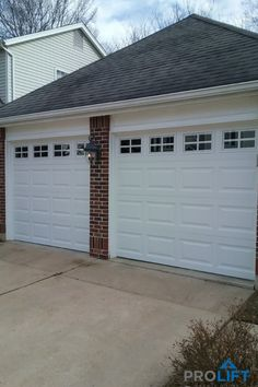 Oftentimes a traditional steel garage door in bright white is THE ideal choice to best complement a home's exterior look. Classic and timeless. Durable and energy efficient. Stylish and budget-friendly. | To see this door (and others!) click through to our photo gallery to view some of our recent garage door ideas and installations. | ProLift Garage Doors of St. Louis | Shown here:  Premium, insulated steel Clopay garage doors with short panels and colonial windows with grilles…