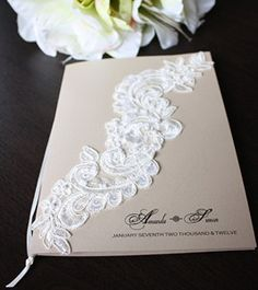Halle Invitation | The Invitation Place | Stunning lace motif design on neutral metallic card. Image shows its use on a church book/order of service