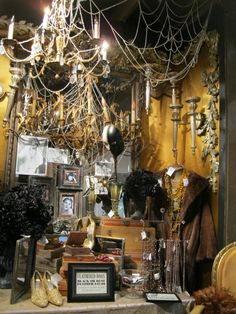 Rogers Gardens Hallowen Decor | there were sparkly cobwebs on old chandeliers,