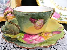 OFFERING THIS PRETTY JUST FANTASTIC TEA CUP AND SAUCER MADE BY LIMOGES FRANCE MARKED AS SHOWN AND WOW WHAT A BEAUTY SUPER DESIGN PAINTED ROSES MADE OF A FINE PORCELAIN CHINA WITH NO WEAR AND NO FADING AND NO CHIPS THIS IS MUCH NICER THEN SHOWN MADE AROUND THE 1920S SUPER DOUBLE