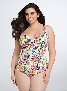 <p>Wallflowers need not apply for this floral print one piece swimsuit. Not only is the multi-color print so eye-catching, the padded Push-Up Demi Bra cups feature a twist front paired with ruched sides (totally flattering). With adjustable straps that can be worn straight or crossed. Lined with power mesh to contour your shape. Adjustable back hook closure and peekaboo cutout.</p>  <ul> <li>Tummy control</li> <li>Nylon/spandex</li> <li>Wash cold, line dry</li> <li>Imported plus size…
