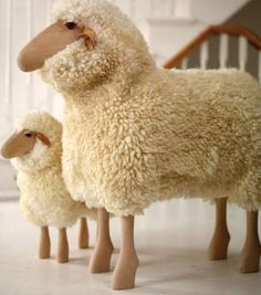 Beautifully made wooden sheep with real soft, fluffy sheepskin. The sheep are strong enough to be used as stools. Made with beech legs, leather ears and sheep skin coat.  H80cm tall.  Reduced from £495.00)