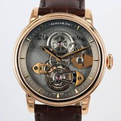 "Arnold and Son TES (Tourbillon Escapement Sapphire), a new tourbillon with an ""inverted"" movement fitted with a sapphire glass barrel bridge"