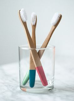 wooden toothbrush, dipped in plasti-dip (to keep the scuz off)!  (via designsponge)  except...i'd just paint the bottoms with my favourite nail polish.