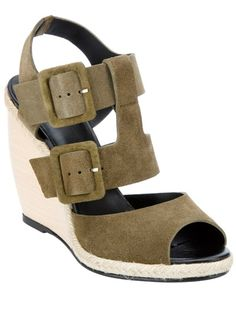 Green calf leather sandal from Pierre Hardy featuring a peep toe, a double buckle and strap fastening to the top with a sling back strap, a contrasting nude braided fabric trim and a wooden block wedge.  £379.00