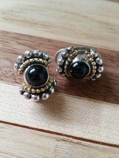 Check out this item in my Etsy shop https://www.etsy.com/listing/502334788/vintage-925-silver-and-black-cabochon