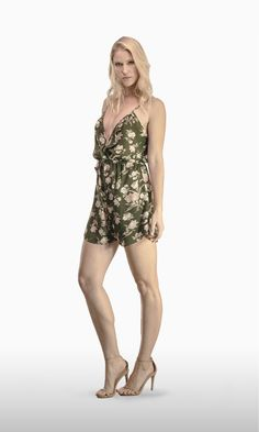 The Lola Romper in Army Floral Crepe | Who doesn't love a jumpsuit short? It's definitely the best choice for a hot summer day on the beach or in town.  JOSA tulum Lola is the next best thing to going naked, with its spaghetti straps, loose fit and V-cut neckline that shows all your sexy assets . . . or you can clip button for a less showy occasion.