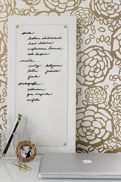 Leather DIY Dry Erase Board.  I assume you might have to be careful when cleaning this board because you might accidentally smear your marker dust/cleaner onto the gorgeous white leather.  [DIY Leather Dry Erase Board by fabricpaperglue]