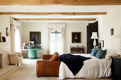 Neutral master bedroom with exposed ceiling beams