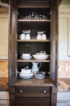 "Tawna Allred's chicken wire hutch in her modern country kitchen.  Stained in a ""black stain"" to contrast with the painted white cabinets."