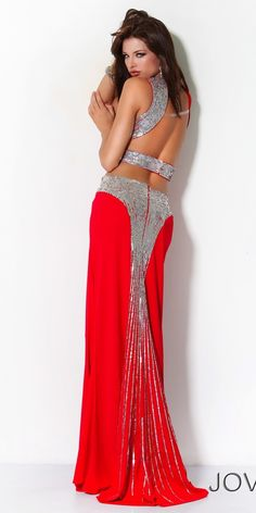 the most amazing sexy red evening gown with stunning back design and silver detail by JOVANI <3