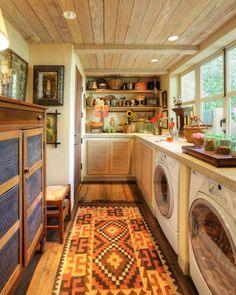 Small Laundry Room Idea with Persian Rug and White Laundry Machine and Wooden Wall Mounted Shelves - Use J/K to navigate to previous and next images