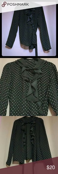Moda international Black wrap around blouse with white dots. Blouse has a ruffle design on the front. Still in good condition.  Blouse  has been worned  once. Moda International Tops Blouses