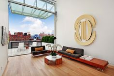 524 West 19th Street Manhattan, Chelsea: Now available for immediate occupancy, the 3++ bedroom, 4 bath custom designed Shigeru Ban Penthouse at Metal Shutter Houses offers views of the Hudson River, Empire State Building and beyond. With 3,319 square feet of interior space, including 3 bedrooms, library and study, and 1,963 exterior square footage including balconies, a terrace and roof deck, the Penthouse is an architecture maximally open to possibilities.