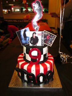 Michael Jackson - One of my daugther's best friend LOVES Michael Jackson and wanted a cake in that theme.  It was difficult to replicate his image so we opted for laminated photos of him doing his signature moves and his album covers.  It was a simple cake...buttercream with fondant accents.  Tana loved her MJ cake!