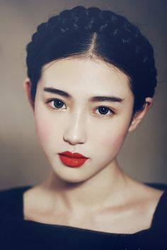 Pale flawless skin, tomato-red lips and matching brush. The dark brows with the dark hair looks amazing.