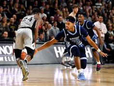 Rhode Island has a great team. This is a decent picture of the players trying to perfect a steal.