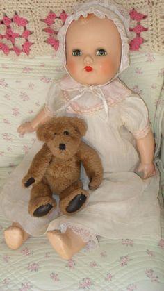 composition baby  doll 25 w/teddy bear   hard plastic large head w/vintage dress