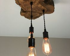 Live-Edge Olive wood Light Fixture with 3 lights. Rustic Industrial Chandelier Modern live edge olive wood light fixture with 3 lights. Industrial Style Lighting, Industrial Chandelier, Rustic Lighting, Rustic Industrial, Vintage Lighting, Home Lighting, Modern Rustic, Bedroom Lighting, Kitchen Industrial