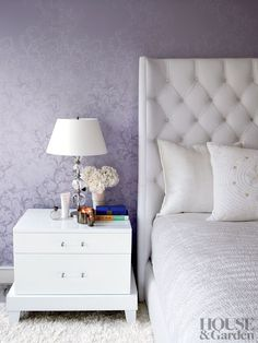 The master bedroom of Gwyneth Paltrow's Hamptons home features a patterned gray wallpaper. #houseandgarden