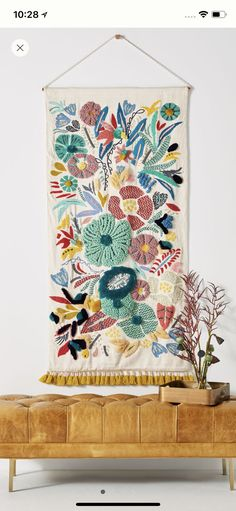 Home Decor Accessories 664351382519022507 - 8 Fall Home Design Trends to Love from Anthropologie – Chic+Fab+Love – Colorful tapestry with boho charm