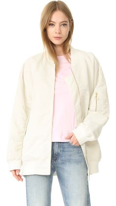 Buy it now. Edition10 Oversized Bomber Jacket - Cloud Dancer. An Edition10 bomber jacket in an oversized silhouette. 2 flap pockets and 1 utility pocket. Ribbed edges. Long sleeves. Lined. Fabric: Smooth weave. 100% polyamide. Wash cold. Imported, China. Measurements Length: 29.25in / 74cm, from shoulder Measurements from size S. Available sizes: L , chaquetabomber, bómber, bombers, elbowdiamond, baseball. Light blue Edition10  bomber jacket  for woman.