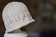 Hat with pattern. http://www.gsheller.com/wp-content/uploads/2009/08/Simple-Newborn-Hat-With-a-Touch-of-Lace.pdf
