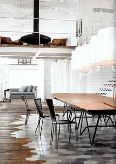 Beautiful kitchen. Notice how hardwood blends with hex tile under dining table.