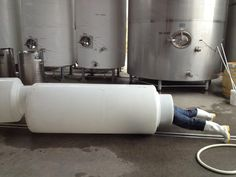 Amisfield Winery: Gill doing 'something' in/to the milk bottle tank?