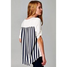 ❗️LAST SMALL❗️GORGEOUS BLACK AND WHITE TOP Love Brandy Melville?  Then you will love April Spirit. Super cute top in White with beautiful black stripped detailing in back, roll up sleeves, and a front pocket. Uber soft, and an amazing quality.  Top has a lot of stretch. 95% Rayon; 5% Spandex. A must-have wardrobe staple. Perfect over leggings, jeans or skirts. Runs true to size. MADE IN USA  THIS LISTING IS AVAILABLE TO PURCHASE TRADES Boutique Tops