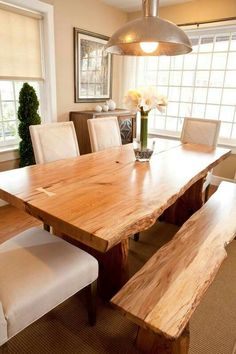 Made from solid wood and iron, your Live Edge Wood Dining Table is hand-sanded, finished and sealed with a durable finish to preserve its raw edge and rustic wood grain. Thanks to natural variations a Dinning Room Tables, Dining Table Design, Dining Area, Dining Rooms, Dining Chairs, Live Edge Tisch, Live Edge Table, Circle Dining Table, Tree Table