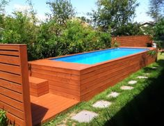swimming pool backyard rectangular above ground lap pool with wooden deck and step above