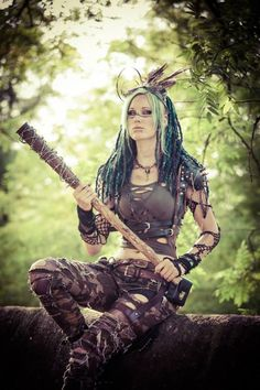 Female Barbarian club costume cosplay | NOT OUR ART - Please click artwork for source | WRITING INSPIRATION for Dungeons and Dragons DND Pathfinder PFRPG Warhammer 40k Star Wars Shadowrun Call of Cthulhu and other d20 roleplaying fantasy science fiction scifi horror location equipment monster character game design | Create your own RPG Books w/ www.rpgbard.com