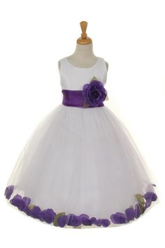 Girls White Dresses with Purple Flower Petals and Sash are a must have for girls who want to look pretty during a wedding or any formal event. Made out of satin, the white dress features a tank bodice                                                                                                                                                                                 More