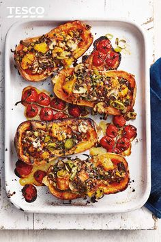 Stuffed butternut squash Make the most of golden butternut squash with this hearty vegan recipe. Caramelised roast squash is stuffed with sweet leeks, nutty bulgur wheat and mushrooms and served with juicy roasted tomatoes for an impressive vegan dinner. Vegan Roast Dinner, Vegan Dinner Recipes, Vegan Dinners, Veggie Recipes, Vegetarian Recipes, Cooking Recipes, Healthy Recipes, Plat Vegan, Tesco Real Food