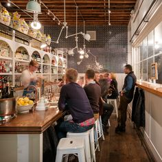 Barnacle, from Renee Erickson and partners, celebrates the Italian apertivo bar. Think wines by the glass; canned, pickled, smoked, and cured seafood plates; house made charcuterie; hand sliced serrano ham; fresh, seasonal vegetable dishes; and an extensi