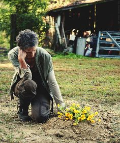 Carol, the flowers ... too many graves. The Walking Dead 4:14 - 'The Grove'.