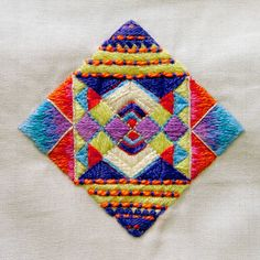 Geo series of miniature embroideries. An opportunity to explore patterns and have a break from type.    Hand embroidered with cotton floss on cotton canvas.  18.5cm x 18.5cm