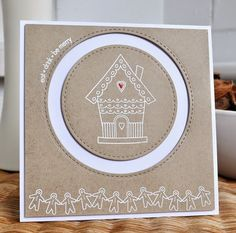 Cute kraft gingerbread Christmas card using Inkydoodles stamps. Love the crisp white embossing and the tiny red glazed heart. By Inkyfingered Carol