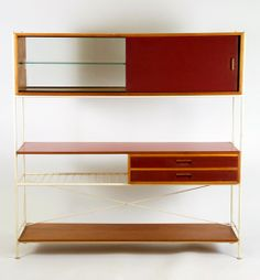 Frank Guille; Laminated Wood, Glass and Enameled Metal Storage Unit for Kandya, 1950s.