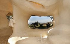 A true curiosity, this cave themed house perched up high on a mountain overlooking the ocean in Malibu California was…