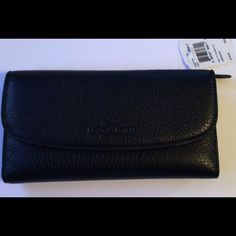 Authentic Coach Black Leather Wallet NWT Authentic Coach Pebble Leather Checkbook Wallet. 12 Credit Card slots, clear window id slot, 3 bill compartments, removable checkbook holder with pen loop, outside back zipper compartment for change. NWT Coach Bags Wallets