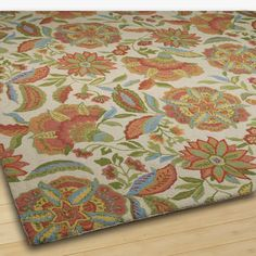 Festive Floral Rug. Vibrant color in a floral abundance design is blooming on this hand-hooked wool area rug. Select from 2 color opti...