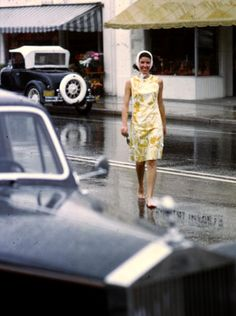 1964 barefoot in the rain with a Lily Pulitzer shift and headscarf - Slim Aarons photo.