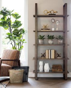 This is a great example of styling bookshelves. Love this look of this bronze etagare