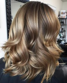 Mid-Length Wavy Layered Hairstyle