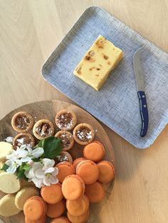 Creme Brûlée fudge on a fog linen board.  Orange macarons, apple blossoms.