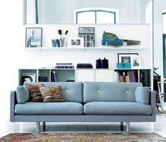 Luxury sofa, love the use of blue throughout