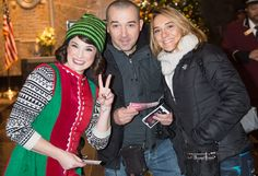"""December 9, 2015: These lucky Empire State Building guests win tickets to """"Elf The Musical"""" as part of the month-long #ESBUnwrapped holiday celebrations!"""